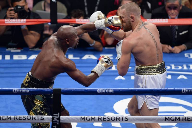 Floyd Mayweather finds Conor McGregor's nose with a left hand.