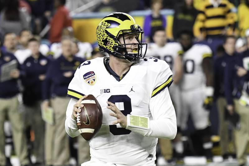 e4058b69fa2 MIAMI GARDENS, FL - DECEMBER 30: Quarterback Wilton Speight #3 of the  Michigan
