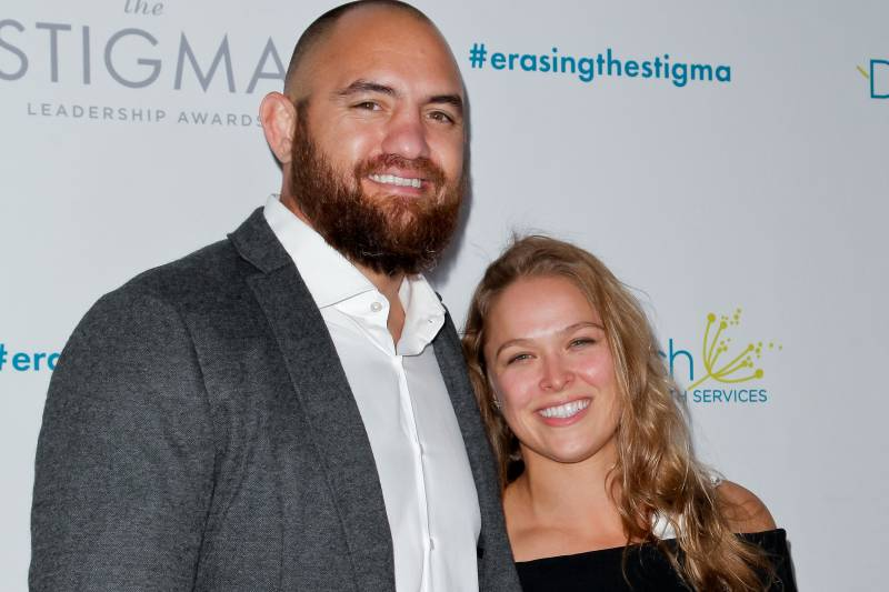 BEVERLY HILLS, CA - APRIL 28: (L-R) Travis Browne and Ronda Rousey attend the 20th anniversary of 'Erasing The Stigma Leadership Awards' at The Beverly Hilton Hotel on April 28, 2016 in Beverly Hills, California. (Photo by Tibrina Hobson/Getty Images)