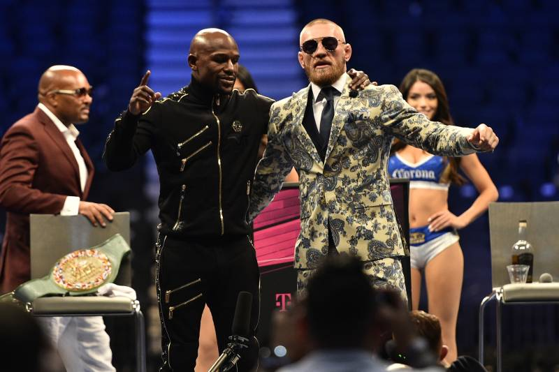 LAS VEGAS, NV - AUGUST 26: (L-R) Floyd Mayweather Jr. and Conor McGregor attend a news conference after Mayweather defeated Conor McGregor by 10th-round TKO in their super welterweight boxing match at T-Mobile Arena on August 26, 2017 in Las Vegas, Nevada. (Photo by Jeff Bottari/Zuffa LLC/Zuffa LLC via Getty Images)