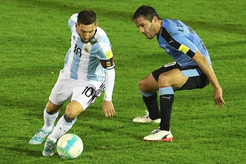 5161133a3f0 Argentina's Lionel Messi (L) is marked by Uruguay's Alvaro Gonzalez during  their 2018 World