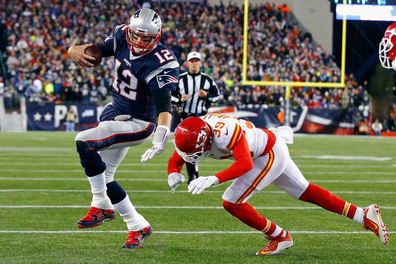 FOXBORO, MA - JANUARY 16: Tom Brady #12 of the New England Patriots runs for the end zone against Husain Abdullah #39 of the Kansas City Chiefs in the first half during the AFC Divisional Playoff Game at Gillette Stadium on January 16, 2016 in Foxboro, Massachusetts.  (Photo by Al Bello/Getty Images)