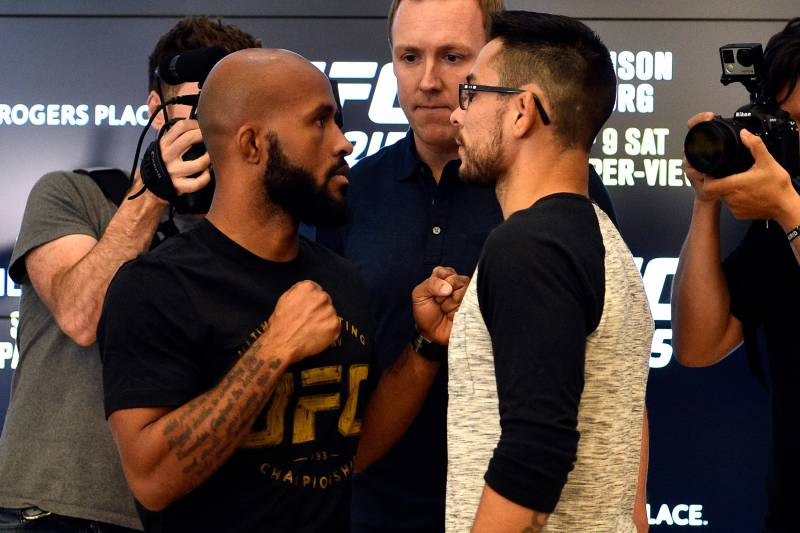 EDMONTON, AB - SEPTEMBER 06: (L-R) UFC flyweight champion Demetrious Johnson and Ray Borg face off for the media during the UFC 215 Ultimate Media Day at Rogers Place on September 6, 2017 in Edmonton, Alberta, Canada. (Photo by Jeff Bottari/Zuffa LLC/Zuffa LLC via Getty Images)