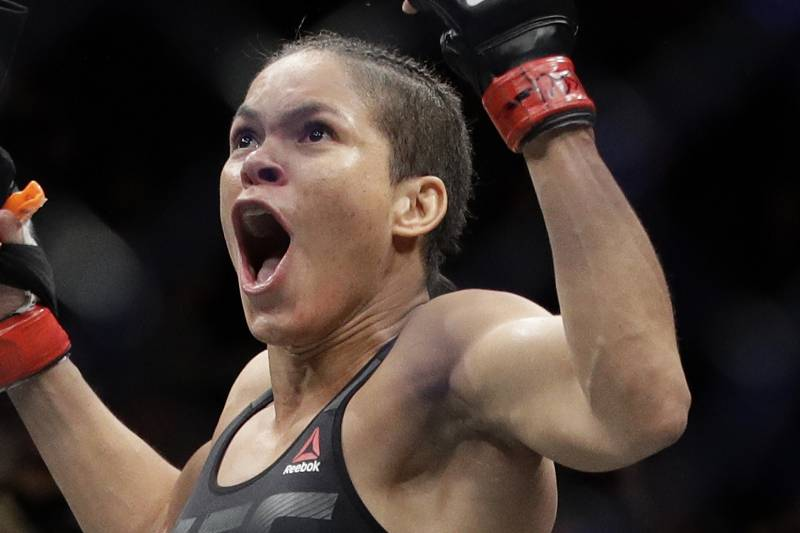 Amanda Nunes celebrates after defeating Ronda Rousey during a women's bantamweight championship mixed martial arts bout at UFC 207, Friday, Dec. 30, 2016, in Las Vegas. (AP Photo/John Locher)