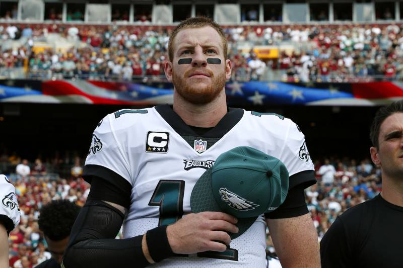 Philadelphia Eagles quarterback Carson Wentz stands on the sideline during a rendition of the national anthem before an NFL football game against the Washington Redskins, Sunday, Sept. 10, 2017, in Landover, Md. (AP Photo/Alex Brandon)