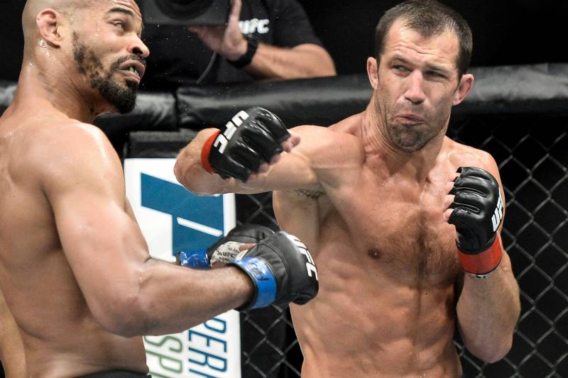 PITTSBURGH, PA - SEPTEMBER 16: (R-L) Luke Rockhold punches David Branch in their middleweight bout during the UFC Fight Night event inside the PPG Paints Arena on September 16, 2017 in Pittsburgh, Pennsylvania. (Photo by Brandon Magnus/Zuffa LLC/Zuffa LLC via Getty Images)