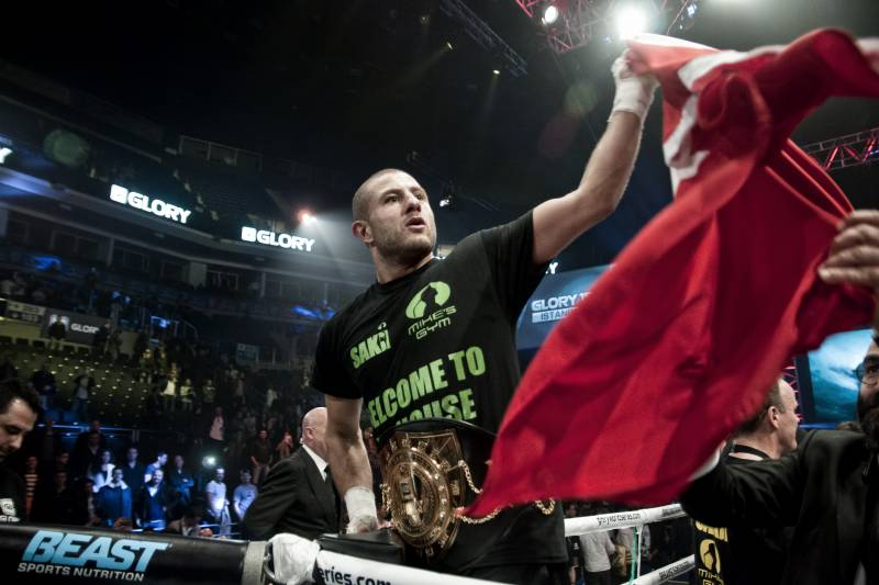 ISTANBUL, TURKEY - APRIL 12: Gohkan Saki waves a turkish flag after winning the Light Heavyweight World title on April 12, 2014 in Istanbul, Turkey. (Photo by Pedro Gomes/Getty Images)
