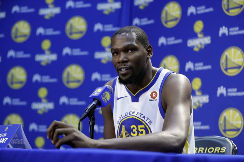 fca18eb089f0 Comments. Golden State Warriors  Kevin Durant during NBA basketball team  media day Friday