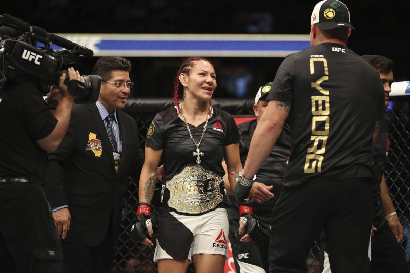 1e1c23610011 ANAHEIM, CA - JULY 29: Cris Cyborg of Brazil celebrates after defeating  Tonya Evinger