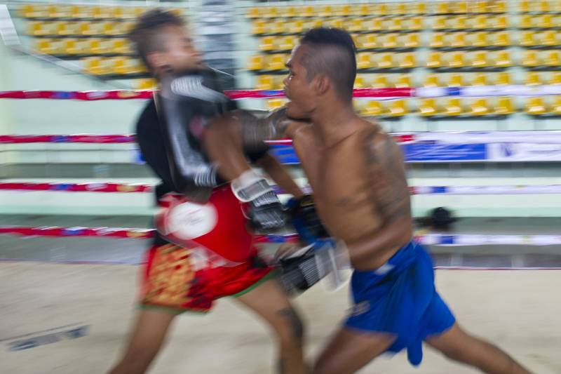 TO GO WITH Myanmar-sport-boxing-equality-culture,FEATURE by Kelly Macnamara This photo taken on July 3, 2015 shows fighter Daw Na Aung (R) practicing Myanmar's homespun martial art Lethwei -- a sport that encourages head-butting and grants victory by knock-out only -- in Yangon. Lethwei fighters say their sport is the toughest member of Southeast Asia's kickboxing family, leaving Thailand's more famous Muay Thai in the blood-flecked dust thanks to its disdain for gloves and use of skull-cracking head-butts. AFP PHOTO / Ye Aung THU (Photo credit should read Ye Aung Thu/AFP/Getty Images)