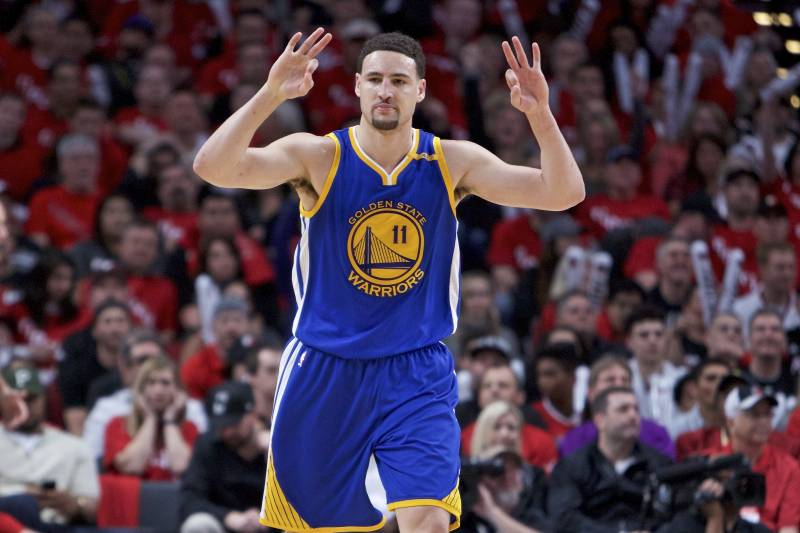 5f2cd26ae12b Golden State Warriors guard Klay Thompson reacts after making a three-point  basket against the