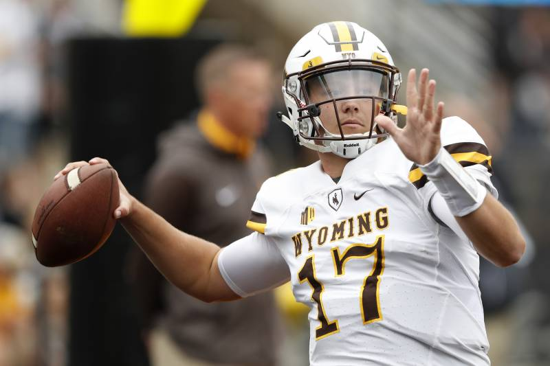 757b64882c4 Wyoming quarterback Josh Allen warms up before an NCAA college football  game against Iowa