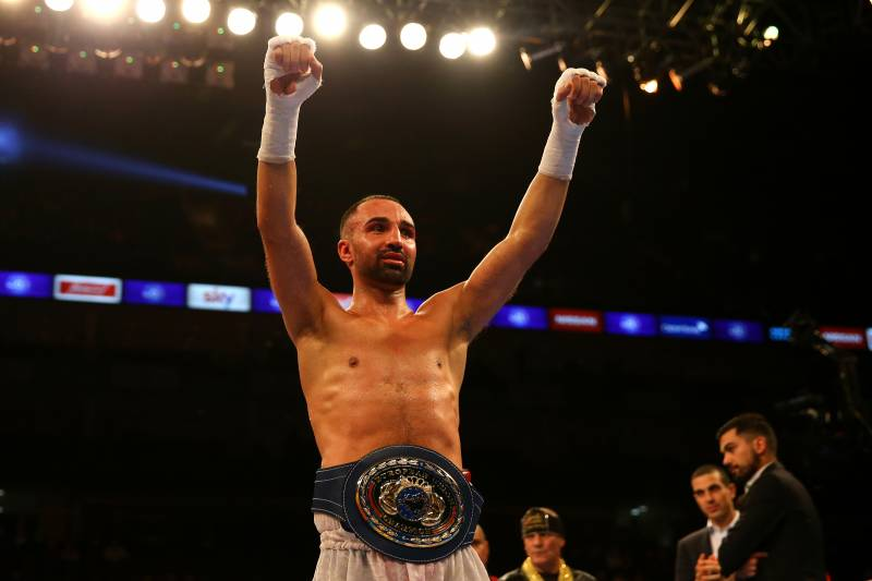 LONDON, ENGLAND - DECEMBER 12:  Paulie Malignaggi (white) celebrates beating Antonio Moscatiello (red) for the Vacant EU Welterweight Championship during the Matchroom Boxing promotion 'Bad Intentions' at The O2 Arena on December 12, 2015 in London, England.  (Photo by Richard Heathcote/Getty Images)