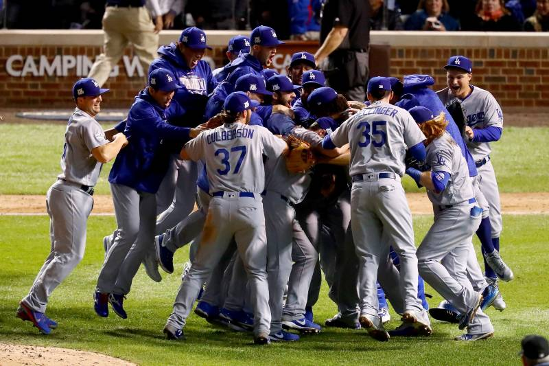 CHICAGO, IL - OCTOBER 19:  The Los Angeles Dodgers celebrate defeating the Chicago Cubs 11-1 in game five of the National League Championship Series at Wrigley Field on October 19, 2017 in Chicago, Illinois. The Dodgers advance to the 2017 World Series.  (Photo by Stacy Revere/Getty Images)