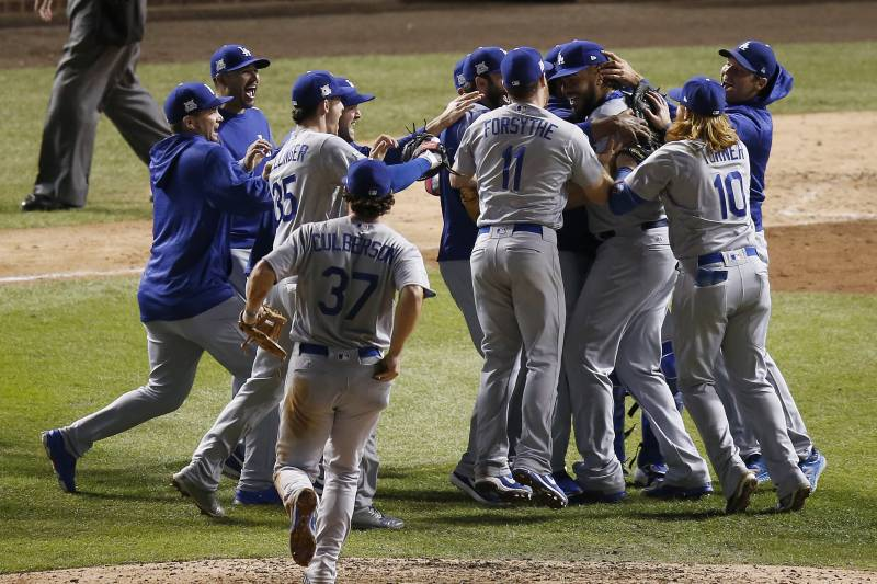 The Dodgers celebrate after winning the National League pennant Thursday night.