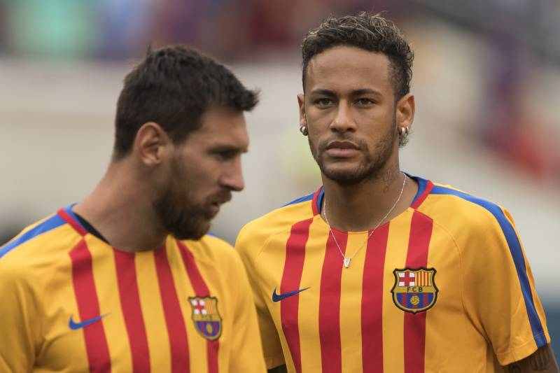 (FILES) This file photo taken on July 22, 2017 shows Neymar (R) and Lionel Messi (L) of FC Barcelona warming up before the International Champions Cup (ICC) match between Juventus FC and FC Barcelona at the Met Life Stadium in East Rutherford, New Jersey. One argument backing Neymar's decision to leave Barca on top of reportedly tripling his wages is to move out of Messi's shadow and compete to become the first Ballon d'Or winner outside of Messi and Ronaldo for a decade. / AFP PHOTO / DON EMMERT (Photo credit should read DON EMMERT/AFP/Getty Images)