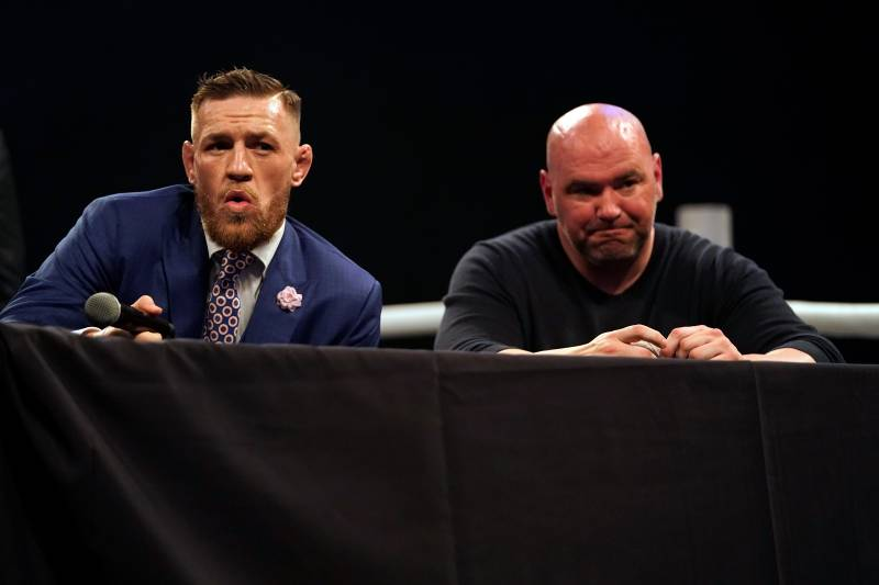 LONDON, ENGLAND - JULY 14: (L-R) Conor McGregor interacts with the media as UFC President Dana White listens on stage during the Floyd Mayweather Jr. v Conor McGregor World Press Tour event at SSE Arena on July 14, 2017 in London, England. (Photo by Jeff Bottari/Zuffa LLC/Zuffa LLC via Getty Images)