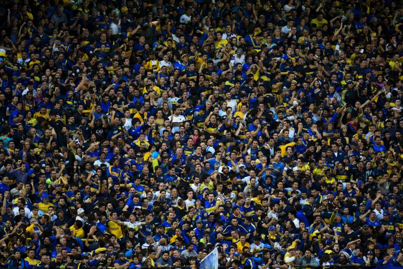 4c7f876e46f Boca Juniors' supporters cheer for their team during the Argentina first  division football match against