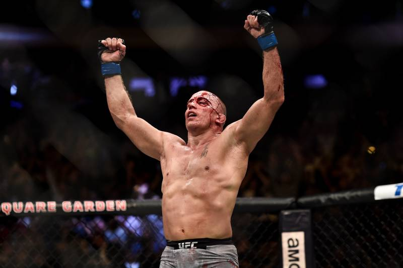 NEW YORK, NY - NOVEMBER 04: Georges St-Pierre of Canada celebrates his submission victory over Michael Bisping of England in their UFC middleweight championship bout during the UFC 217 event inside Madison Square Garden on November 4, 2017 in New York City. (Photo by Brandon Magnus/Zuffa LLC/Zuffa LLC via Getty Images)