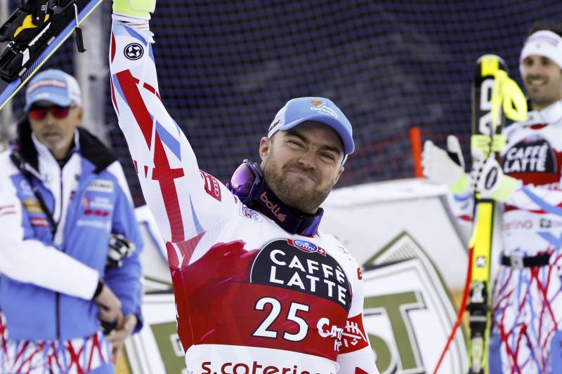 FILE - In this Tuesday, Dec. 29, 2015 file photo, France's David Poisson celebrates his third place after completing a men's World Cup downhill in Santa Caterina Valfurva, Italy. French downhiller David Poisson died on Monday, Nov. 13, 2017 following a training crash in Canada. The French skiing federation said in a statement that the 35-year-old Poisson, who won a bronze medal in the downhill at the 2013 world championships, was training in the Canadian resort of Nakiska for World Cup races in North America. (AP Photo/Alessandro Trovati, file)