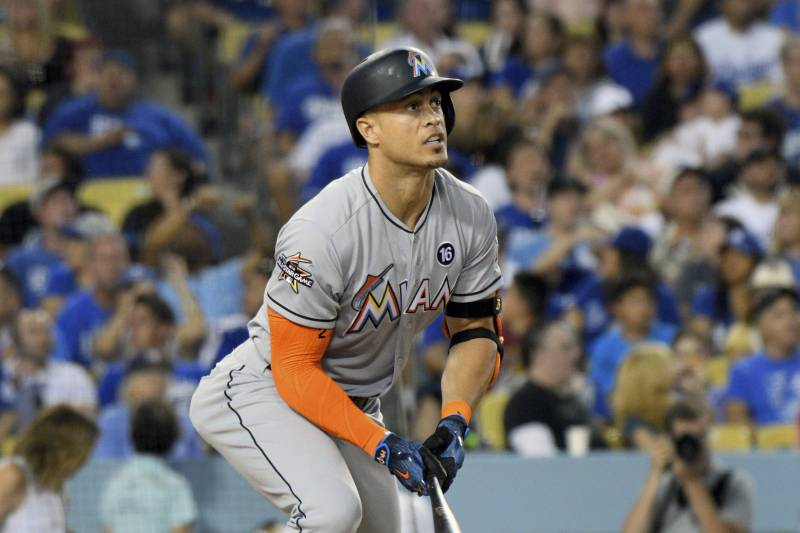 9186548a6 Miami Marlins  Giancarlo Stanton watches the flight of his double against  the Los Angeles Dodgers