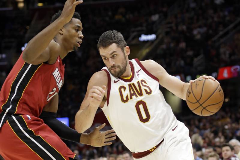 35cc0f84817f Cleveland Cavaliers  Kevin Love (0) drives against Miami Heat s Hassan  Whiteside (21