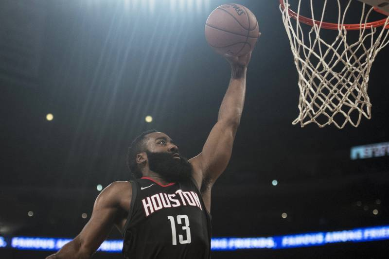 ca0c7b1acd7 Houston Rockets guard James Harden goes up for a dunk during the first half  of an