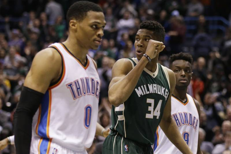 92b96fa4fc7 Milwaukee Bucks  Giannis Antetokounmpo (34) pumps his fist as Oklahoma City  Thunder s Russell