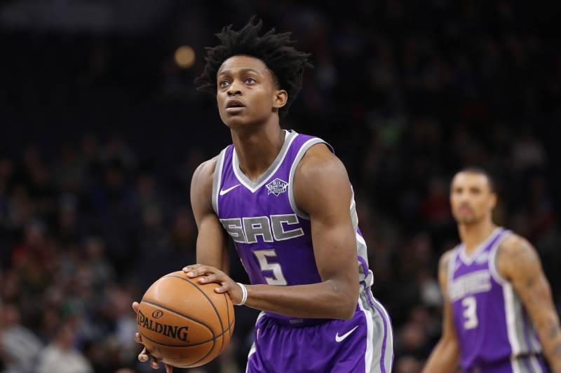 MINNEAPOLIS, MN - DECEMBER 14: De'Aaron Fox #5 of the Sacramento Kings shoots a free throw against the Minnesota Timberwolves on December 14, 2017 at Target Center in Minneapolis, Minnesota. NOTE TO USER: User expressly acknowledges and agrees that, by downloading and or using this Photograph, user is consenting to the terms and conditions of the Getty Images License Agreement. Mandatory Copyright Notice: Copyright 2017 NBAE (Photo by Jordan Johnson/NBAE via Getty Images)