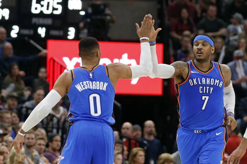 c8553484a95 Oklahoma City Thunder s Russell Westbrook (0) receives a high-five from  teammate Carmelo