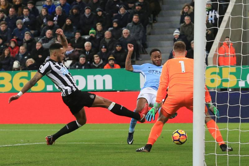 ef5b6567a5498 Manchester City s English midfielder Raheem Sterling (C) scores the opening  goal during the English