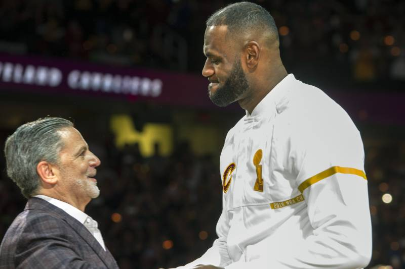ac0d2627d56 Cleveland Cavaliers  LeBron James accepts his NBA championship ring from Cavaliers  owner Dan Gilbert before