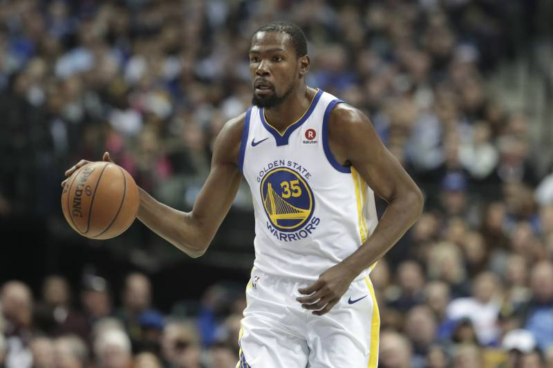 best website b60a0 64e59 Golden State Warriors forward Kevin Durant dribbles during the first half  of an NBA basketball game