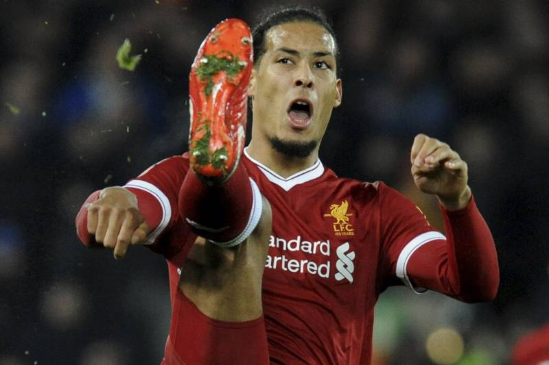 871e0baebaf Liverpool's Virgil van Dijk reaches for the ball during the English FA Cup  Third Round soccer