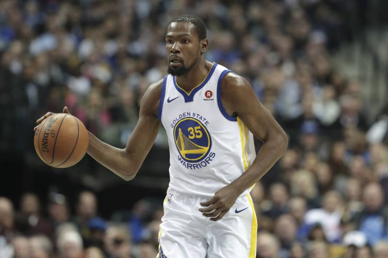 7d71981e665 Golden State Warriors forward Kevin Durant dribbles during the first half  of an NBA basketball game
