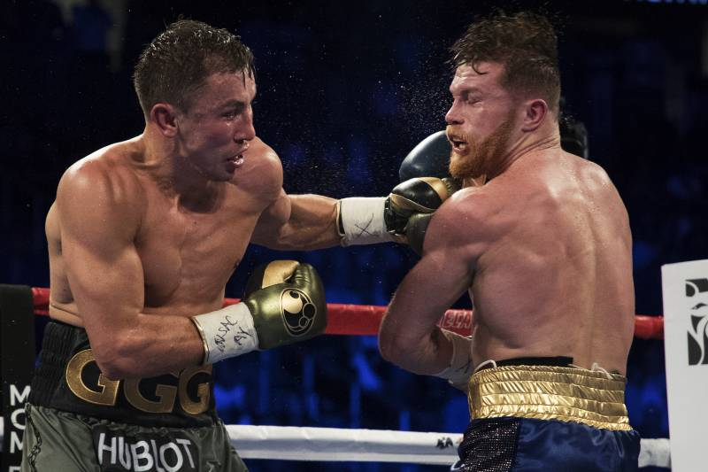 LAS VEGAS, NV - SEPTEMBER 16:  Gennady Golovkin punches Canelo Alvarez during their WBC, WBA and IBF middleweight championship bout at T-Mobile Arena on September 16, 2017 in Las Vegas, Nevada.  (Photo by Al Bello/Getty Images)