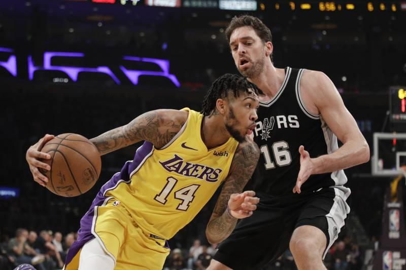 8829af53212 Los Angeles Lakers' Brandon Ingram, left, drives past San Antonio Spurs' Pau