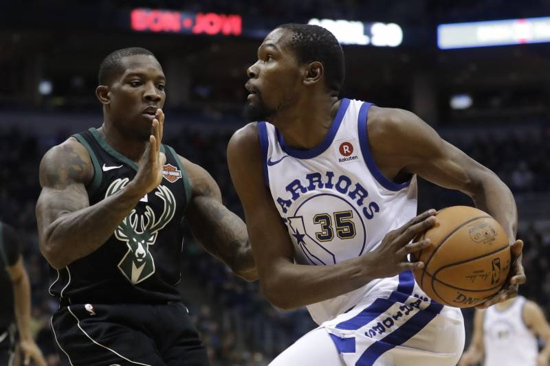 6a98ce3a84b Golden State Warriors  Kevin Durant drives past Milwaukee Bucks  Eric  Bledsoe during the first