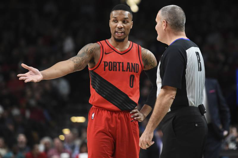 91190d38413 Portland Trail Blazers guard Damian Lillard has some words with referee  Monty McCutchen during the first