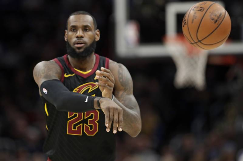 2baaabf1e283 Cleveland Cavaliers  LeBron James passes in the first half of an NBA  basketball game against