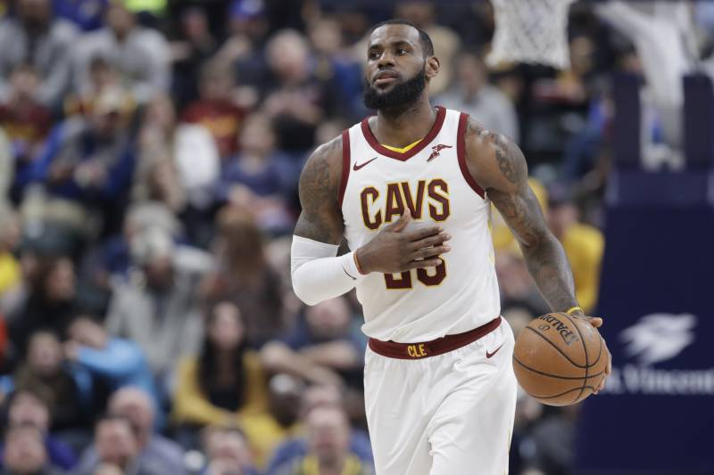 e4be389e1de0 Cleveland Cavaliers  LeBron James dribbles during the first half of an NBA  basketball game against