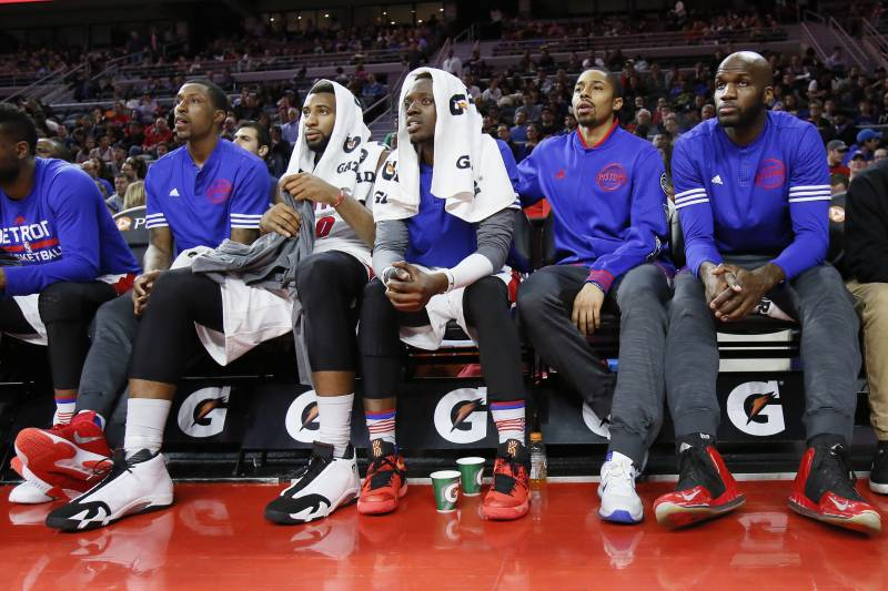 Detroit Pistons' Kentavious Caldwell-Pope, from left, Andre Drummond, Reggie Jackson, Spencer Dinwiddie and Joel Anthony watch from the bench during the first half of an NBA basketball game against the Atlanta Hawks Wednesday, March 16, 2016, in Auburn Hills, Mich.  (AP Photo/Duane Burleson)