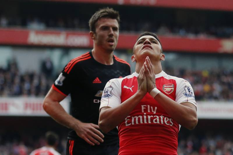 Bleacher report sports highlights news now arsenals alexis sanchez reacts after missing a chance to score a goal during the english premier stopboris Images
