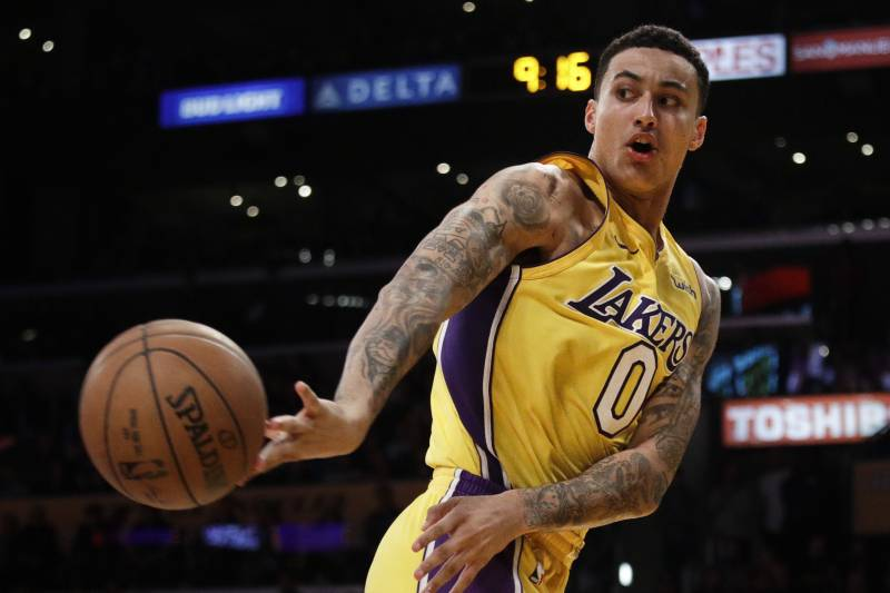 dd4c30ac659e Los Angeles Lakers  Kyle Kuzma passes the ball during the second half of an  NBA