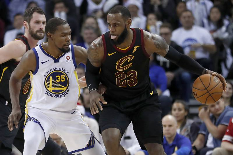 9db0606ffe7 Cleveland Cavaliers forward LeBron James (23) moves the ball around Golden  State Warriors forward