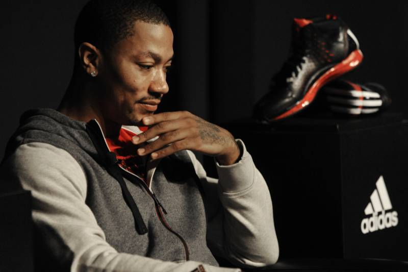 f7aed102c76 Chicago Bulls player Derrick Rose looks on while unveiling his new shoe the  Adidas D Rose