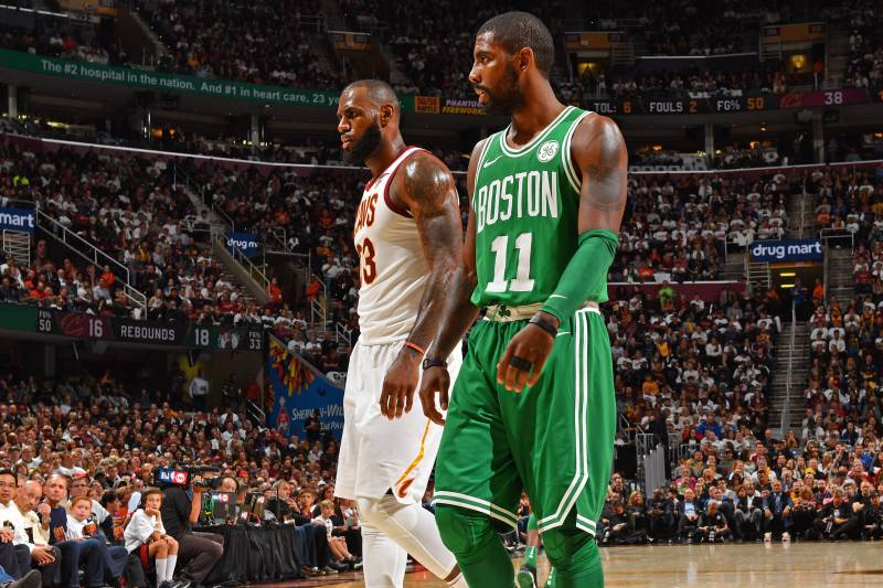 CLEVELAND, OH - OCTOBER 17: Kyrie Irving #11 of the Boston Celtics and LeBron James #23 of the Cleveland Cavaliers walk up court on October 17, 2017 at Quicken Loans Arena in Cleveland, Ohio. NOTE TO USER: User expressly acknowledges and agrees that, by downloading and/or using this Photograph, user is consenting to the terms and conditions of the Getty Images License Agreement. Mandatory Copyright Notice: Copyright 2017 NBAE (Photo by Jesse D. Garrabrant/NBAE via Getty Images)