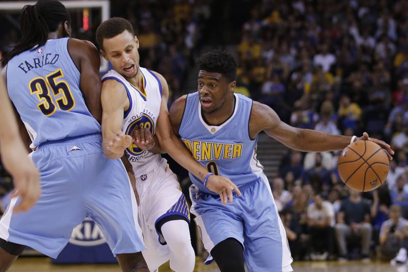 1fb555cf24b9 Denver Nuggets  Emmanuel Mudiay (0) dribbles around Golden State Warriors   Stephen Curry