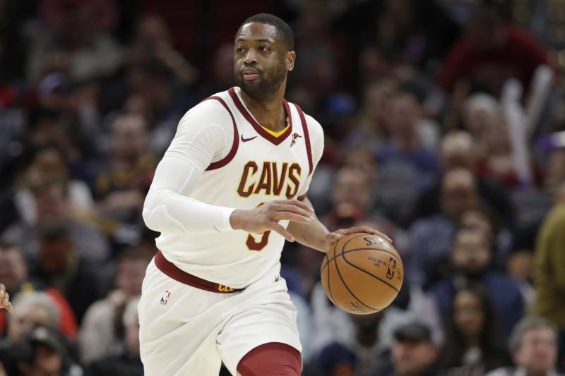 532cd4b602c0 Cleveland Cavaliers  Dwyane Wade drives against the Miami Heat in the first  half of an