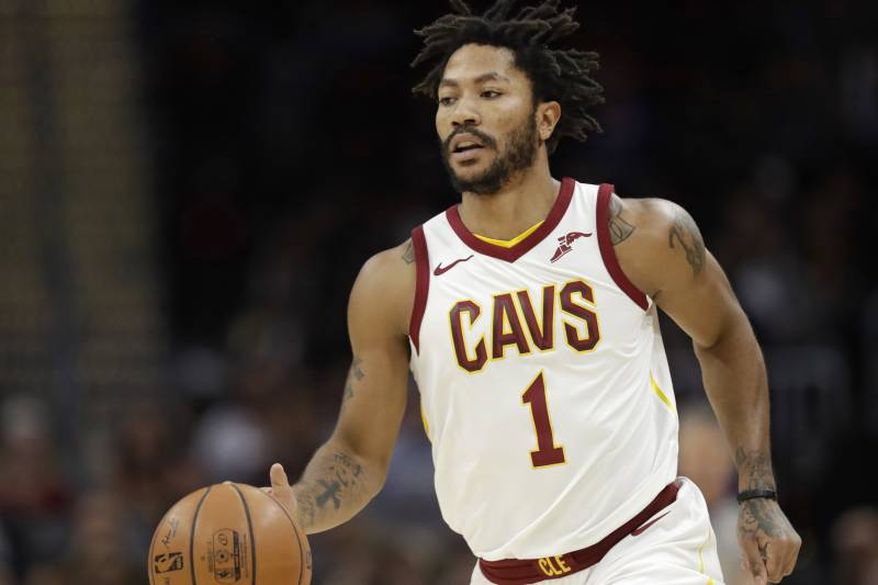 dde5d9faffeb Cleveland Cavaliers  Derrick Rose drives against the Miami Heat in the  first half of an